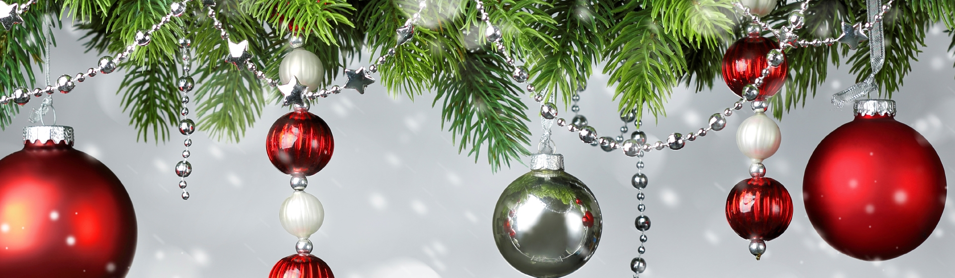 Christmas ornaments hanging from a tree.