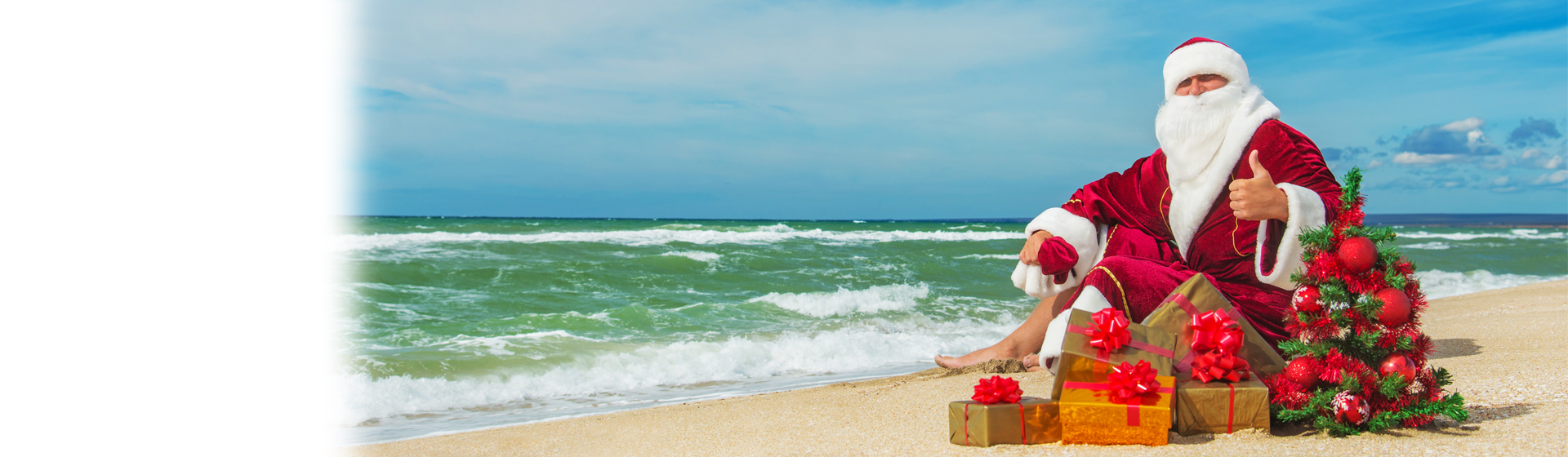 Santa and presents on the beach