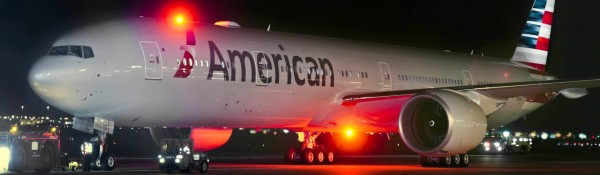 American Airlines plane on the ground at night.