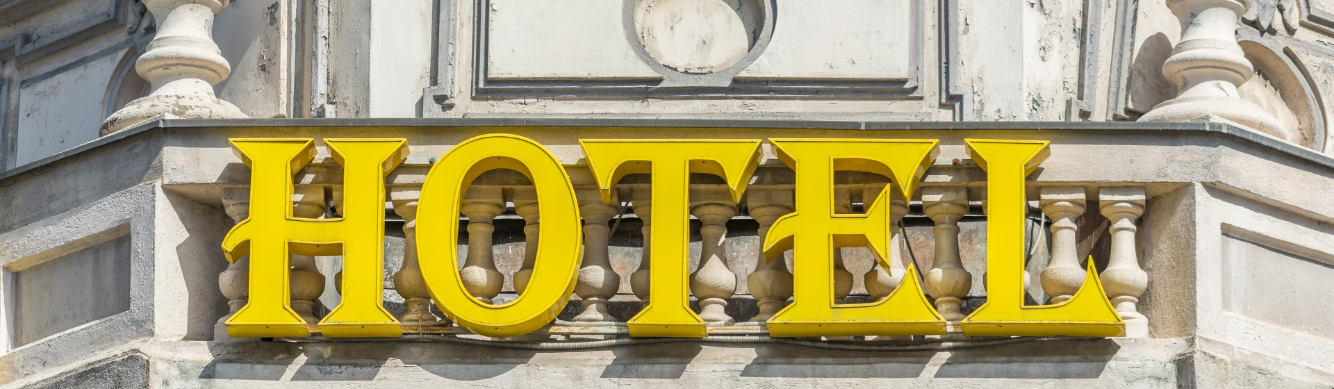 Yellow hotel sign.