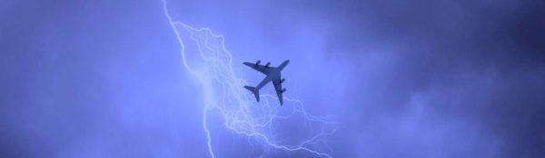 Plane in stormy sky