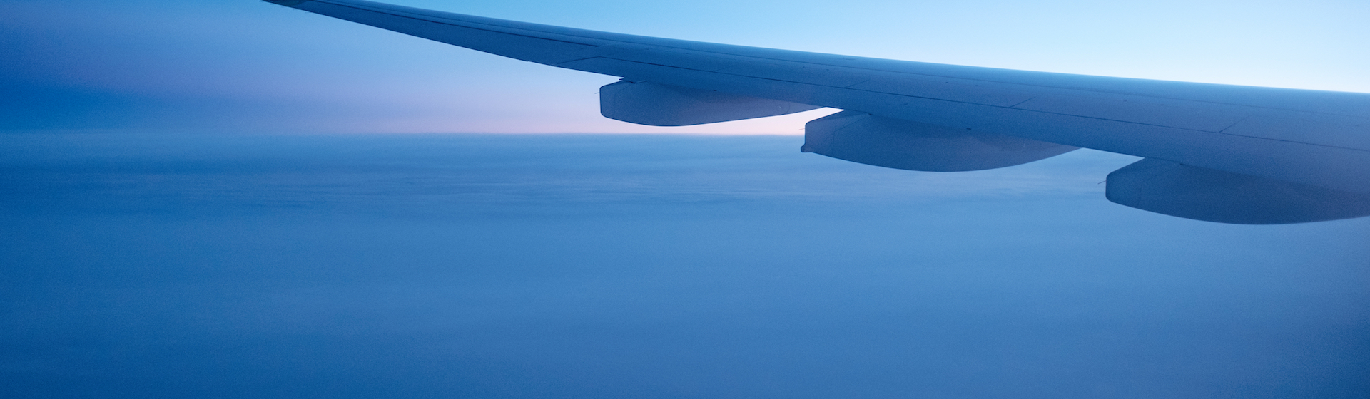 Airplane wing in the sky