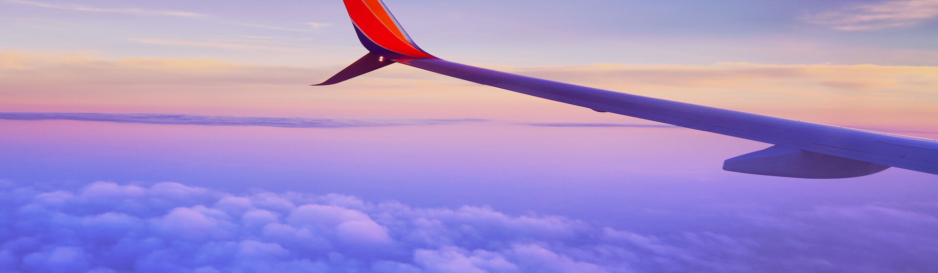 Plane wing in sky