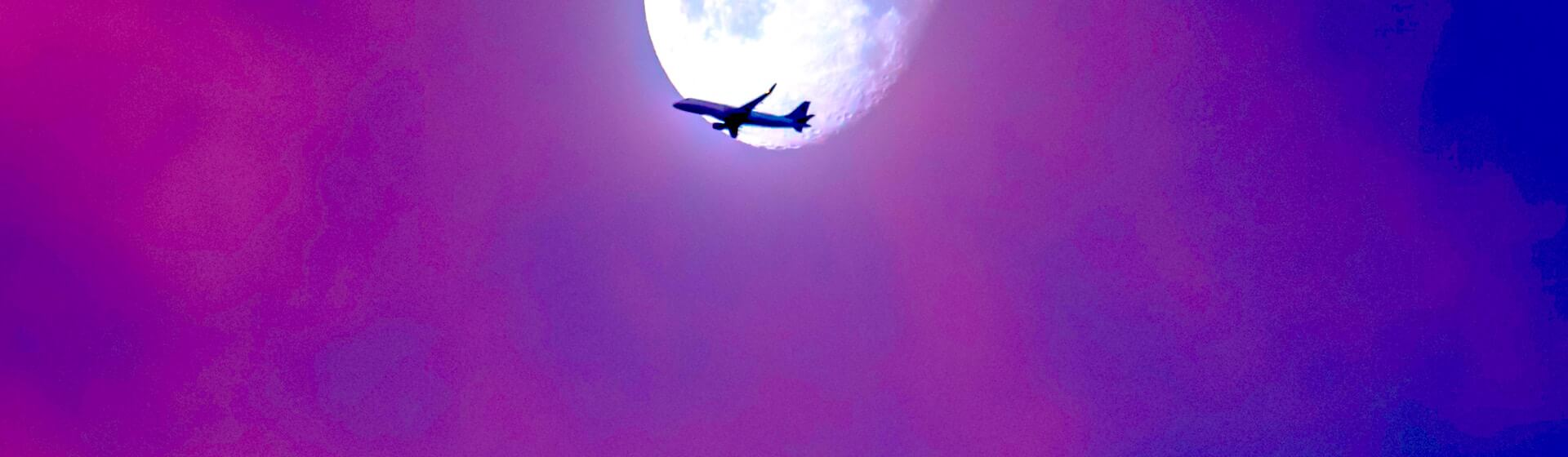 Plane passing by the moon